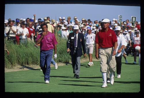 A thoughtful Severiano Ballesteros walking up the eighth fairway with Payne Stewart during their Saturday fourball during the 1991 Ryder Cup