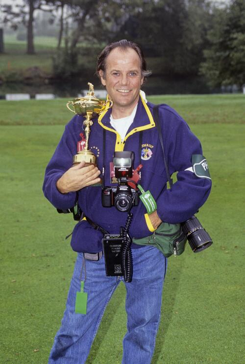 Photographer Lawrence Levy holding the Ryder Cup
