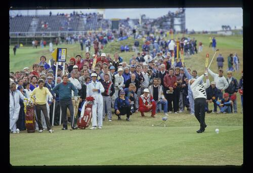 Manuel Pinero and Raymond Floyd watch Greg Norman tee off on his way to the 1986 Open Championship