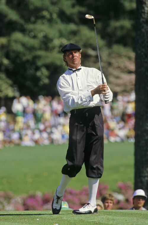 Golfer Payne Stewart on the tee at The Masters wearing his formal Plus-Fours