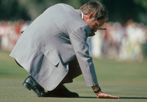 A course official checking the rub of the green before play at the Phoenix Open Championship