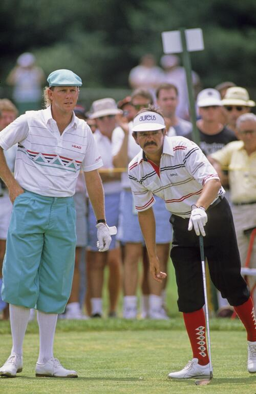 American Payne Stewart and Australian Rodger Davis in their Plus-Fours on the tee