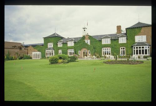The putting green and the Clubhouse at The Belfry