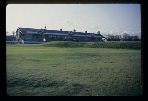 The racecourse grandstand and the first hole, 'Short', at the oldest golf course in the world, Musselburgh Links