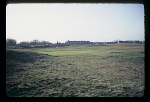 Golf in raw form at the oldest golf course in the world, Musselburgh Links with Arthur's Seat in the background