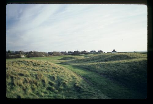 Houses and low dunes surround the fairway at Royal St Georges
