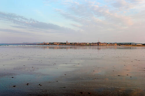 [St Andrews in distance from West Sands]