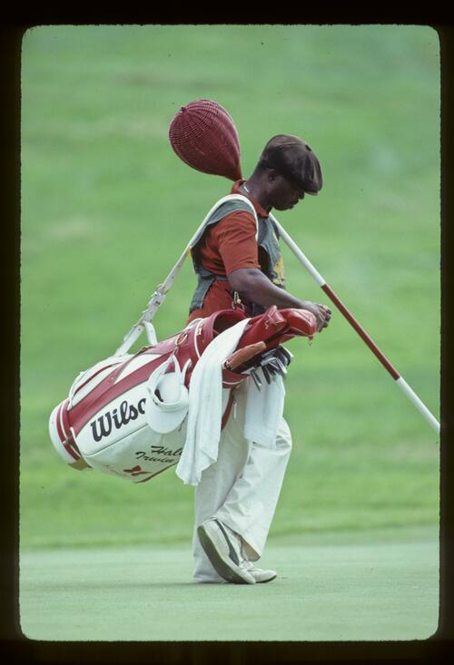 Hale Irwin's caddie looking relaxed on the green during the 1981 US Open