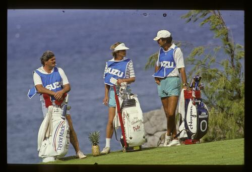 Caddies relaxing on the tee during the 1986 Isuzu Kapalua International