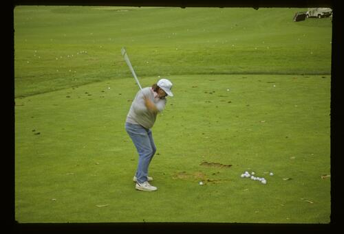 Fluff Cowan trying his hand on the range during the 1987 US Open