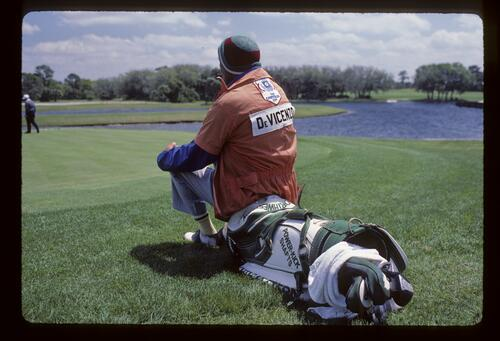 Roberto De Vicenzo's caddie sitting on the bag during the 1987 Chrysler Cup