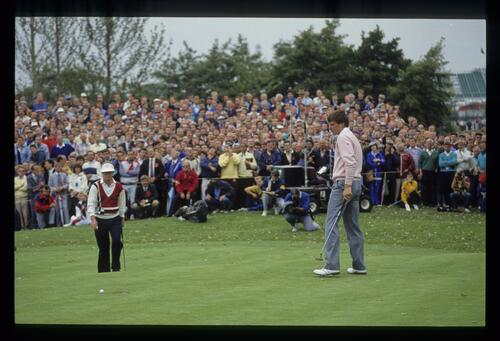 A good gallery looking on as Nick Faldo is disappointed as a putt slips past while Tom Kite walks up the hill for his own attempt in the foursomes on the first morning of the 1989 Ryder Cup