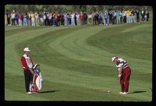 The ball just leaving the club face as Tom Kite hits an iron from the fairway at the 1989 Ryder Cup