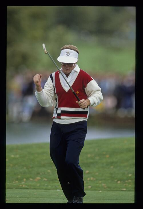 Tom Kite punching the air in celebration having sunk a putt at the 1989 Ryder Cup