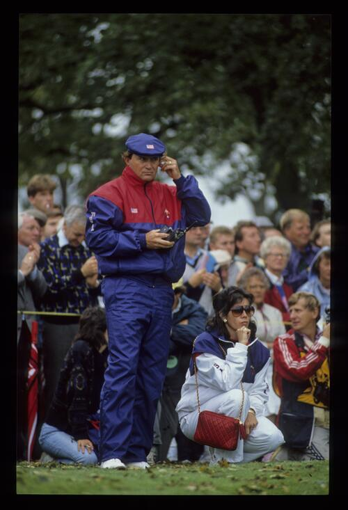 American captain Raymond Floyd keeping in touch electronically, accompanied by his wife at the 1989 Ryder Cup