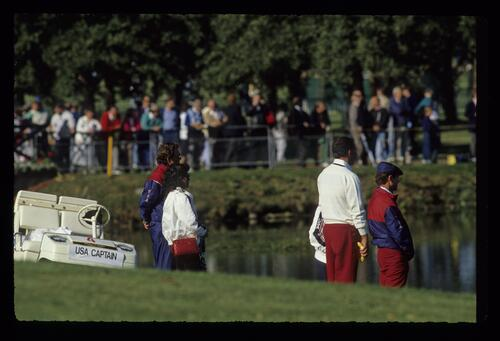 American captain Raymond Floyd, his wife Maria, Mark O'Meara and Tom Watson waiting for a match to come over the lake to the 18th green at the 1989 Ryder Cup