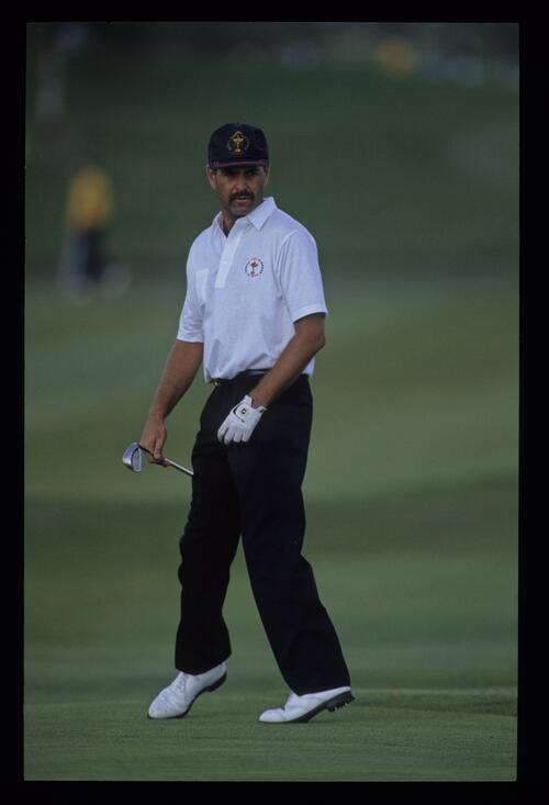 Mark James appears to be dancing in anticipation having chipped from the fringe at the 1989 Ryder Cup