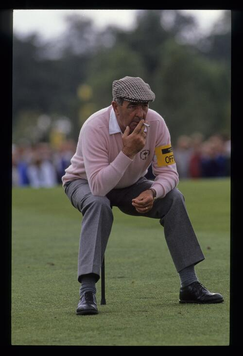 Sam Torrance's father and coach, Bob Torrance, relaxes on a shooting stick with a cigarette at the 1989 Ryder Cup
