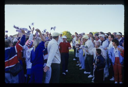 A jubilant gallery form a corridor for Tom Kite at the 1987 Ryder Cup