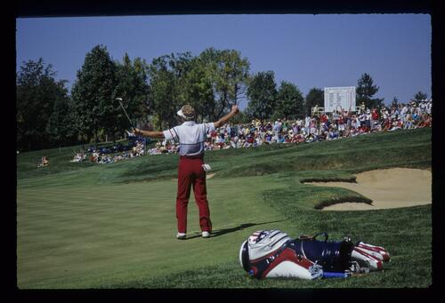 Tom Kite celebrating after sinking a long putt at the 1987 Ryder Cup