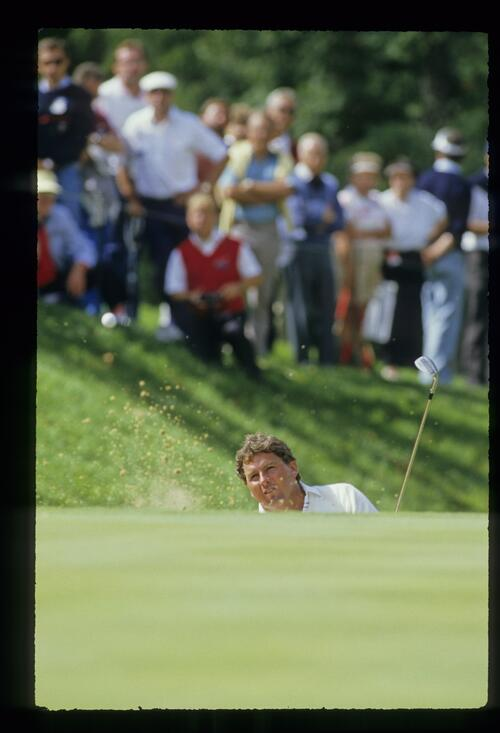 Sand and ball fly as Lanny Wadkins exits a bunker at the 1987 Ryder Cup