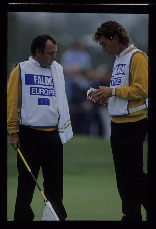 The caddies of Nick Faldo and Ian Woosnam confer at the 1989 Ryder Cup
