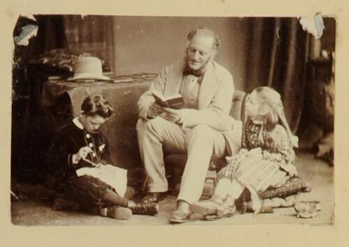 [William Heriot Maitland Dougall and two of his children]