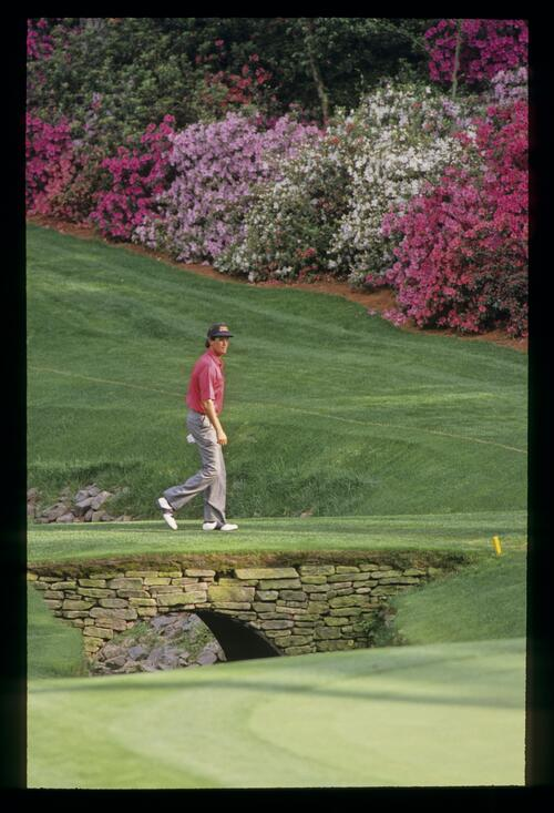 Ian Baker Finch striding across the bridge during the 1992 Masters