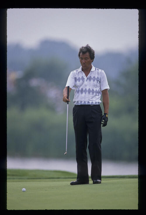 Isao Aoki lining up a putt during the 1989 USPGA