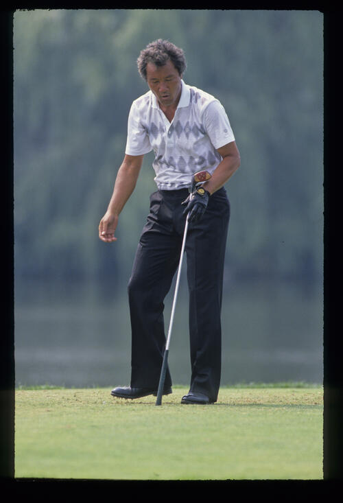 Isao Aoki looking concerned on the tee during the 1989 USPGA