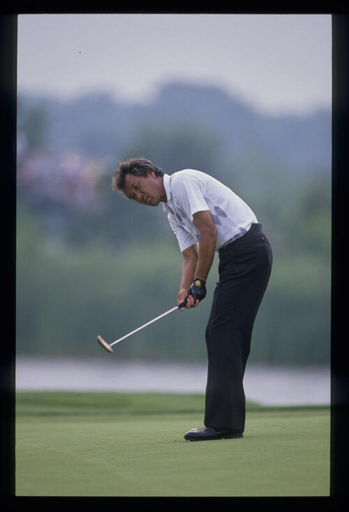 Isao Aoki urging a putt to drop during the 1989 USPGA