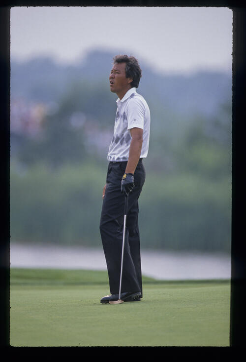Isao Aoki looking disappointed on the green during the 1989 USPGA