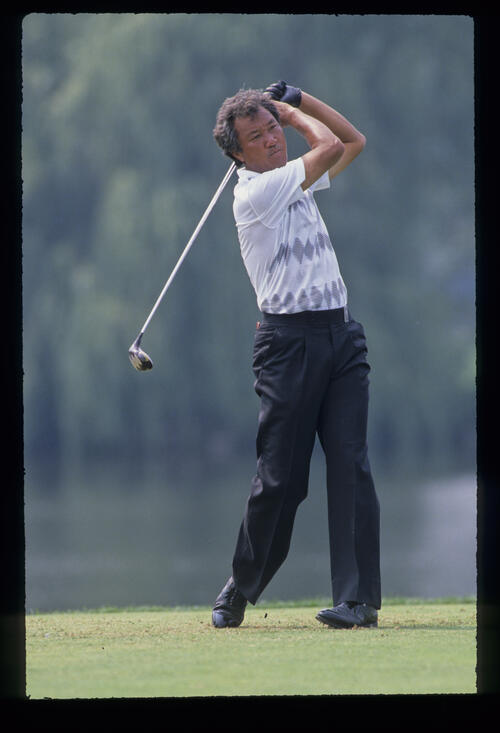 Isao Aoki following through after driving during the 1989 USPGA