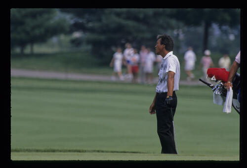 Isao Aoki turning away in disgust from his shot during the 1989 USPGA