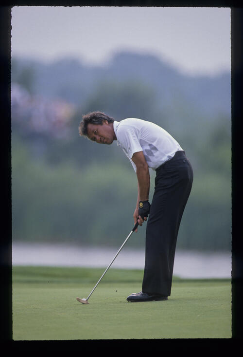 Isao Aoki preparing to putt during the 1989 USPGA