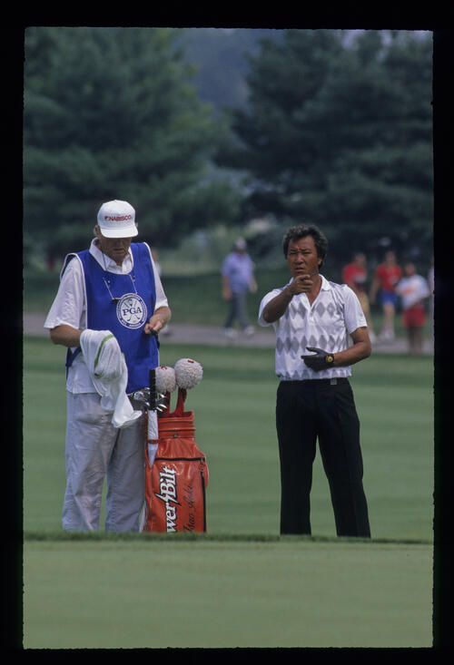 Isao Aoki and caddie in collaboration during the 1989 USPGA