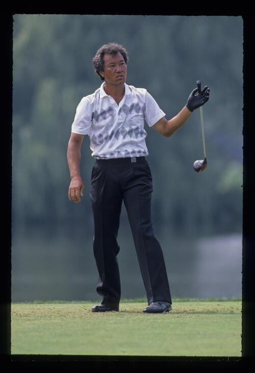 Isao Aoki dropping his driver on the tee during the 1989 USPGA