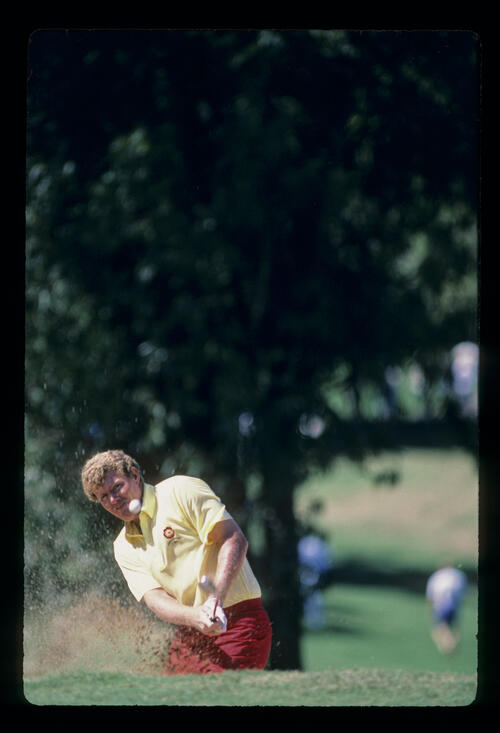 Andy Bean splashing from a bunker during the 1984 Kapalua International