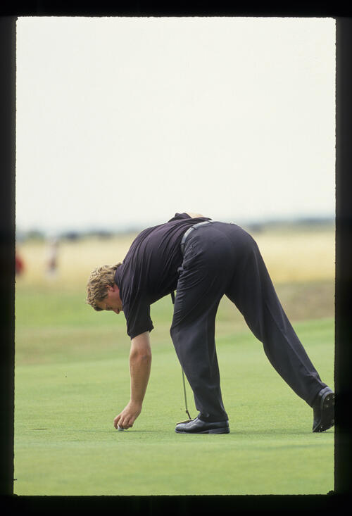 Howard Clark replacing his ball on the green during the 1993 Open Championship