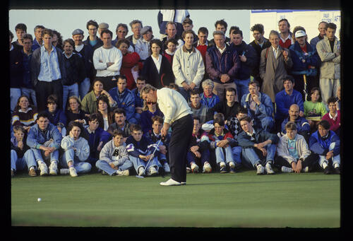 Howard Clark sending a putt on its way during the 1990 Dunhill Cup