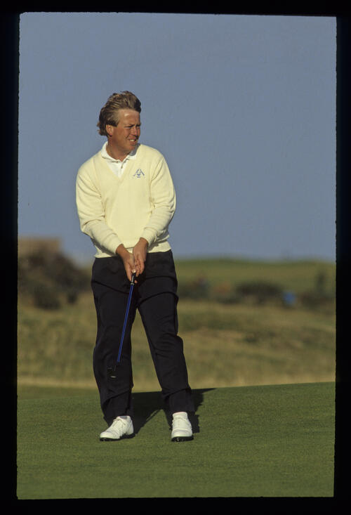 Howard Clark looking windswept on the green during the 1990 Dunhill Cup