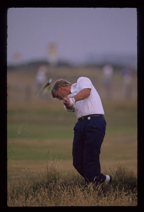 Howard Clark hitting from the thick rough during the 1989 Open Championship