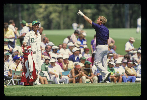 Howard Clark pointing to the sky during the 1987 Masters