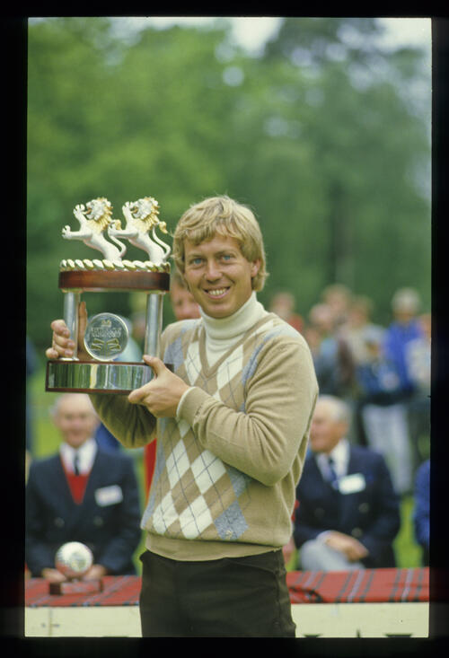 Howard Clark holding the trophy aloft after winning the 1984 Whyte & MacKay PGA