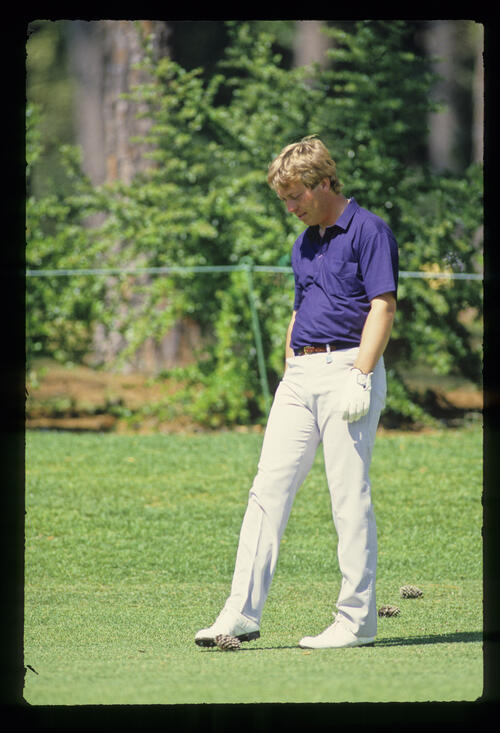 Howard Clark kicking a pine cone on the fairway during the 1987 Masters