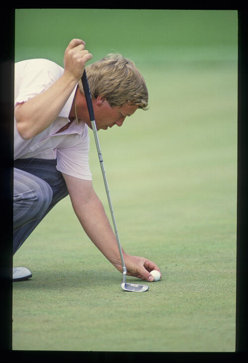 Howard Clark replacing his ball on the green during the 1987 Masters