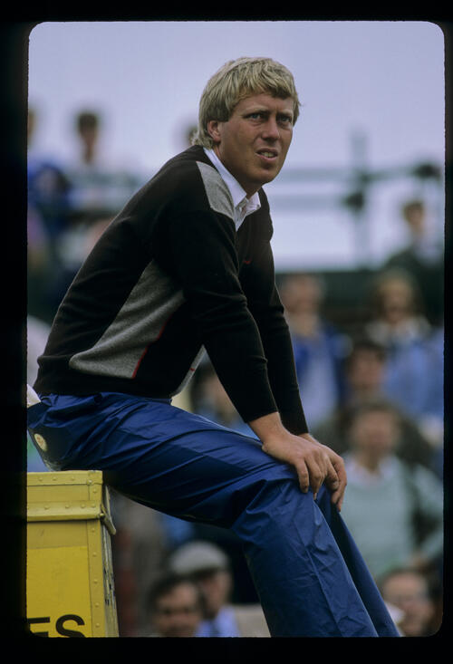 Howard Clark sitting on a tee box during the 1985 Open Championship