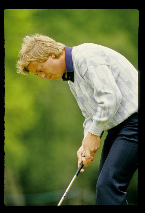 Howard Clark crouching over a putt during the 1986 Whyte & MacKay PGA