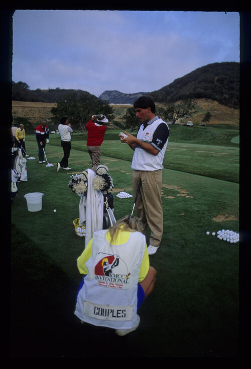 Fred Couples and Raymond Floyd together on the practice ground during the 1990 RMCC Invitational
