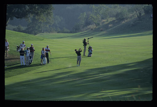 Fred Couples and Raymond Floyd together on the fairway during the 1990 RMCC Invitational